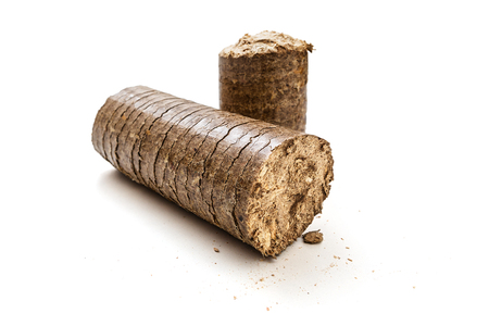 filings: Wooden briquettes on a white background -Clipping Path Stock Photo