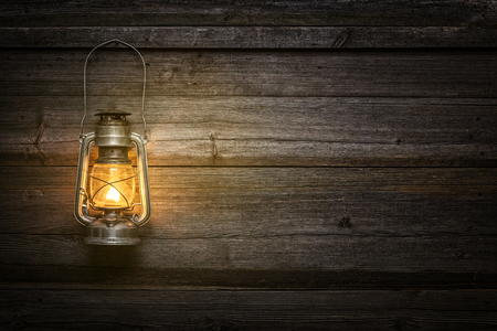 oil lamp: Oil lamp at night on a wooden wall