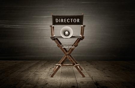 Director chair and megaphone, scene in dark room