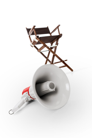 filmmaker: Megaphone and director chair in background -Clipping Path