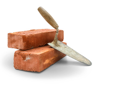 stainless: Bricks and trowel on white background,  included clipping path Stock Photo