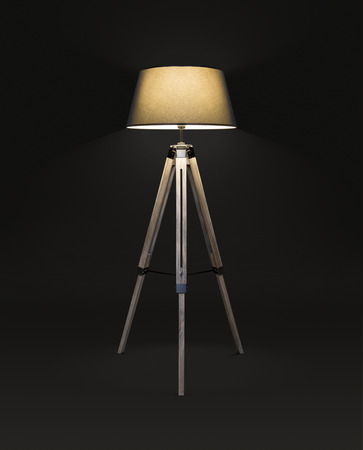 Wooden floor tripod lamp with telescopic legs on black background, included clipping path