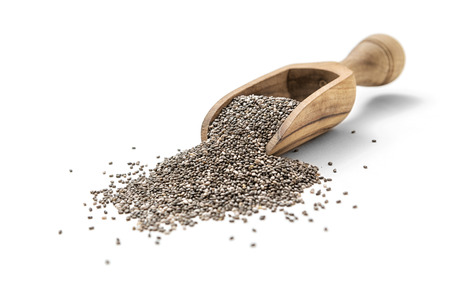 Chia seeds in scoop on white background Stock Photo