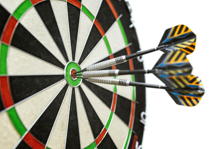 Dart in bulls eye of dartboard with shallow depth of field concept for hitting target Banque d'images