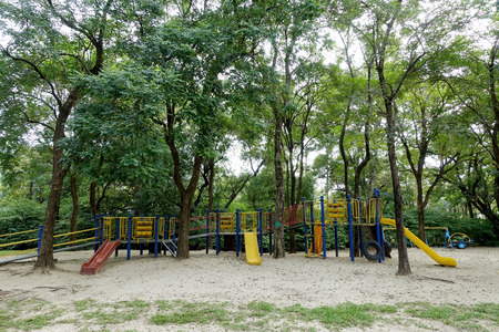 Empty playground surround by trees