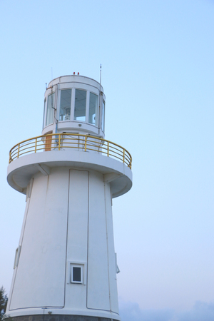 murk: The lighthouse on the twilight time Stock Photo