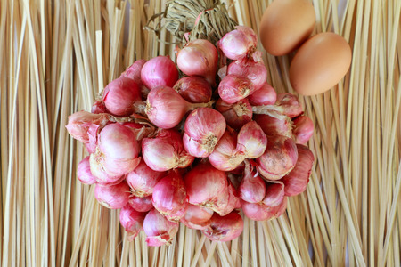 shallot: Red shallot on the wood background