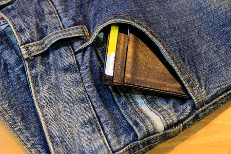 clothes organizer: trousers Jeans with cadit card  on the wood table Stock Photo