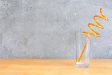 shooter drink: Water glass on the wood table in front of the cement wall background
