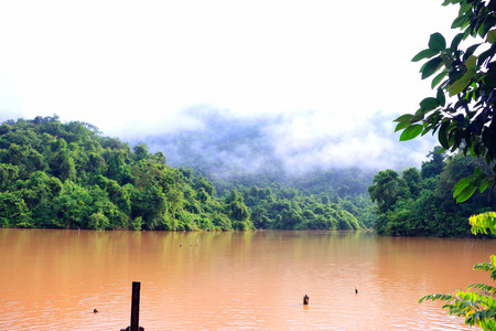 natual: Morning Fog on the mountain behind the red river in Chiang Khan district -Loei ,Thailand