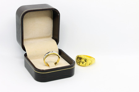 Dimond ring in the brown color box on the white background