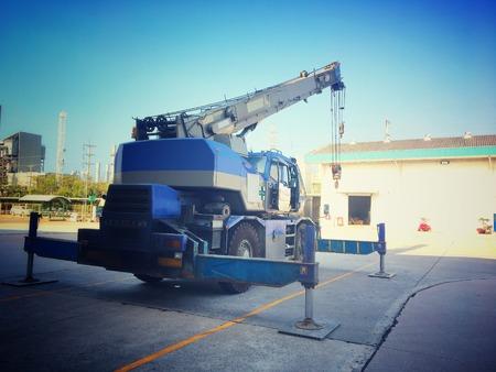 Crane car stop on the heavy factory field. Stock Photo - 107253105