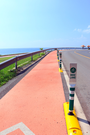Bike lane in side the sea and mountain Stock Photo