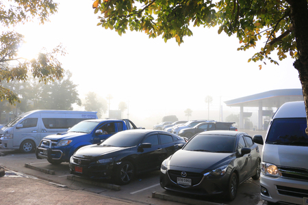 Oil station in Loei city -Thailand : Thai tourist  parking the car after driving from banglok to loei city 600 km On 29 Dec 2017 ,07.00 am.