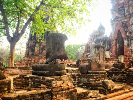 ancient remains of thai people ,Buddha head in the banyan tree of historical park Stock Photo
