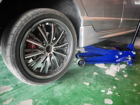 Rubber wheel of the owner car is leak come to repair in maintenance shop garage