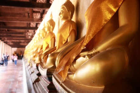 Buddha image god within gold colored in the ayutthaya historical park Thailand Editorial