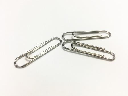 Paper clip on the white background-Office tool.