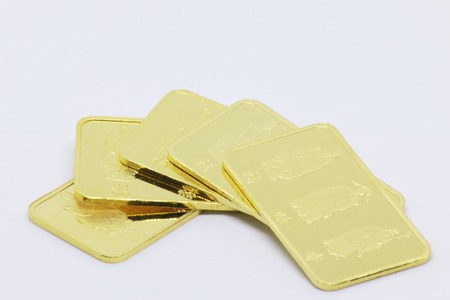 Gold bar ingot close up on the white background Stock Photo