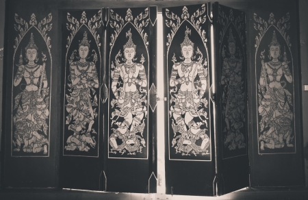 Decorated wooden doors at the temple in Thailand. photo
