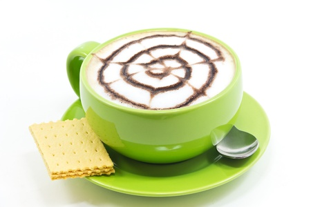 stiring: Cappuccino in a cup of green on a white background. Stock Photo