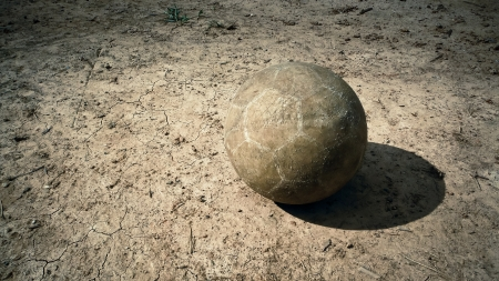 Old soccer ball on the ground  photo