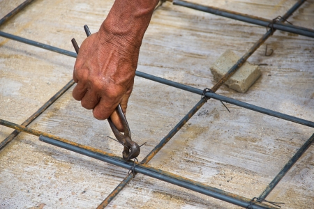 Laborers are tied to concrete reinforcement wire  Stock Photo