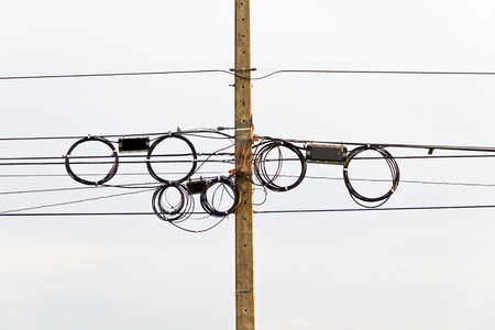 Electric power lines on poles  photo