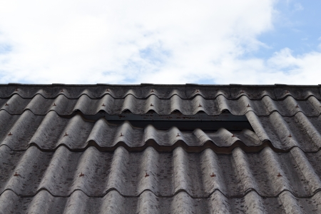minimize: Old roof should be made to minimize noise  Stock Photo