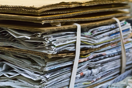 inconclusive: Piles of paper stacked several layers Put the document together