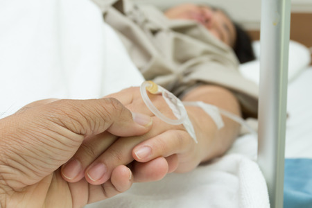 hand grip: Hand grip with concern.IV solution in a patients hand