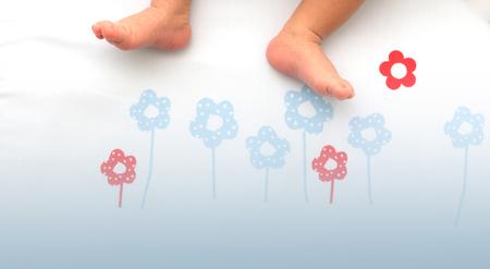 sleeping pad: Baby feet.Childrens feet on the floor sleeping pad. Stock Photo