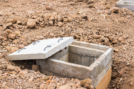 Close up of new concrete cover and concrete manhole at construction site. Stock Photo