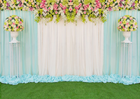 wedding backdrop: Beautiful backdrop flowers and fabric for wedding ceremony. Stock Photo