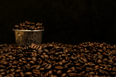 aluminum: Coffee beans and stainless steel cup with copy space.