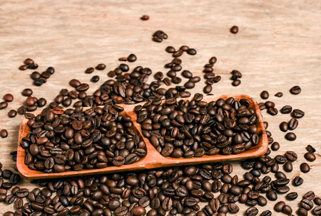 Coffee beans and wooden container with copy space. Stock Photo