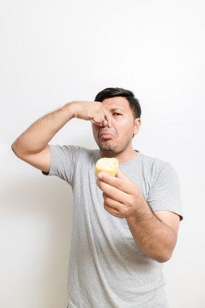 Asian man with durian on white background