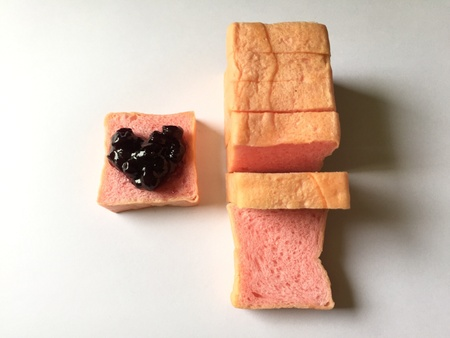 Pink sliced breads and heart blueberry jam
