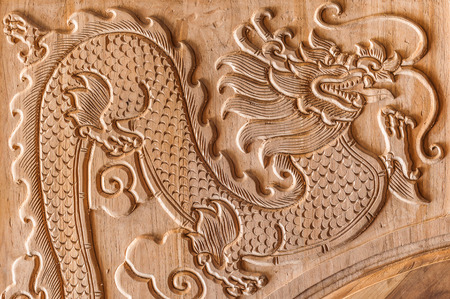 not painted: dragon carving on the wood not yet painted Stock Photo