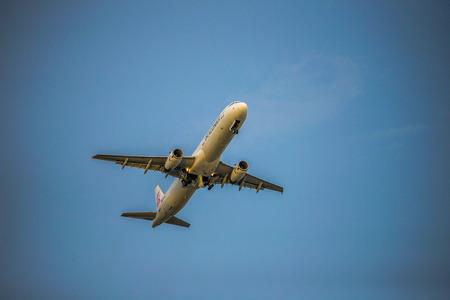 Dragon air line take off from Phuket International Airport Stock Photo