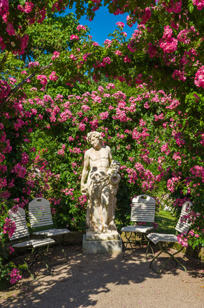 statuary garden: Rose Arches and gods statue in the Rose Garden Beutig, Black Forest, Baden-Wurttemberg, Germany, Europe Stock Photo