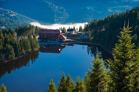 black forest: The lake Mummelsee and the mountain hotel in Seebach, Black Forest, Baden-Wuerttemberg, Germany, Europe Editorial