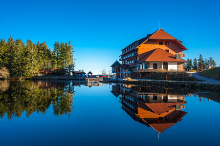 The lake Mummelsee and the mountain hotel in Seebach, Black Forest, Baden-Wuerttemberg, Germany, Europe Editorial