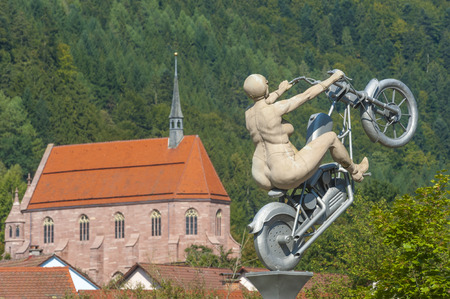 woodland sculpture: The Marienkapelle of the monastery Hirsau with the sculpture the rocker bride of this artist Peter Lenk, Black Forest, Baden-Wurttemberg, Germany, Europe