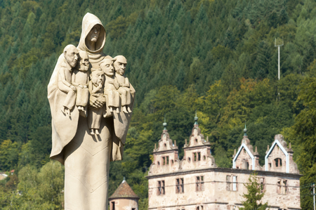 woodland sculpture: Cloister Hirsau with the sculpture monk figure of the artist Peter Lenk, Black Forest, Baden-Wurttemberg, Germany, Europe