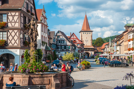 The historic Old Town with Upper Gate Tower and Rhr fountain in Gengenbach, Black Forest, Baden-Wurttemberg, Germany, Europe 에디토리얼