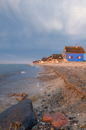 Holiday cottage on the peninsula and nature reserve Graswarder in Heiligenhafen at the Baltic Sea Reklamní fotografie