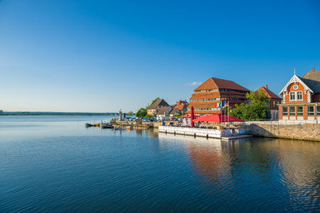 View over the Neustadter inland waters to the granary and a restaurant on the shore in Neustadt Holstein at the Baltic Sea