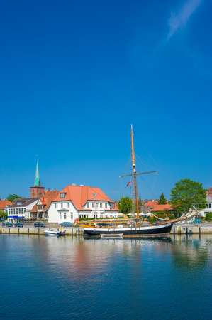 Townscape at the harbor with traditional sailing ships in Neustadt Holstein at the Baltic Sea