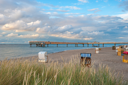 View from the beach toward the pier of Heiligenhafen at the Baltic Sea Stock Photo